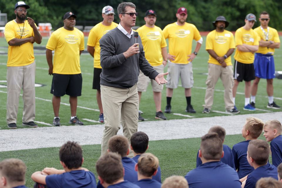 Jim Harbaugh speaks to campers at Al Glick Youth football camp
